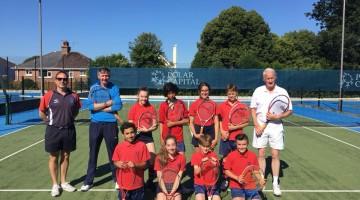 Students meet Sir Stephen Dalton (Jersey's Lieutenant Governor) at the Grainville Tennis Club